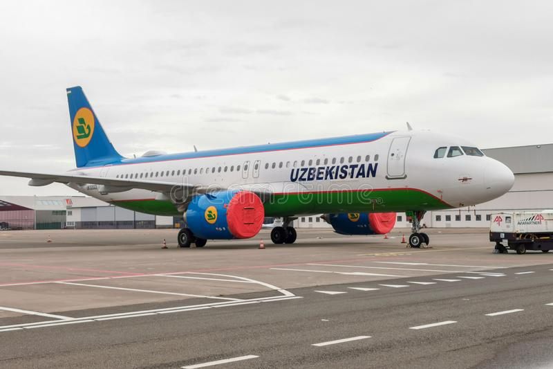 Uzbekistan Airways Airbus A320 Neo. Parked on platform with engine covers stock images