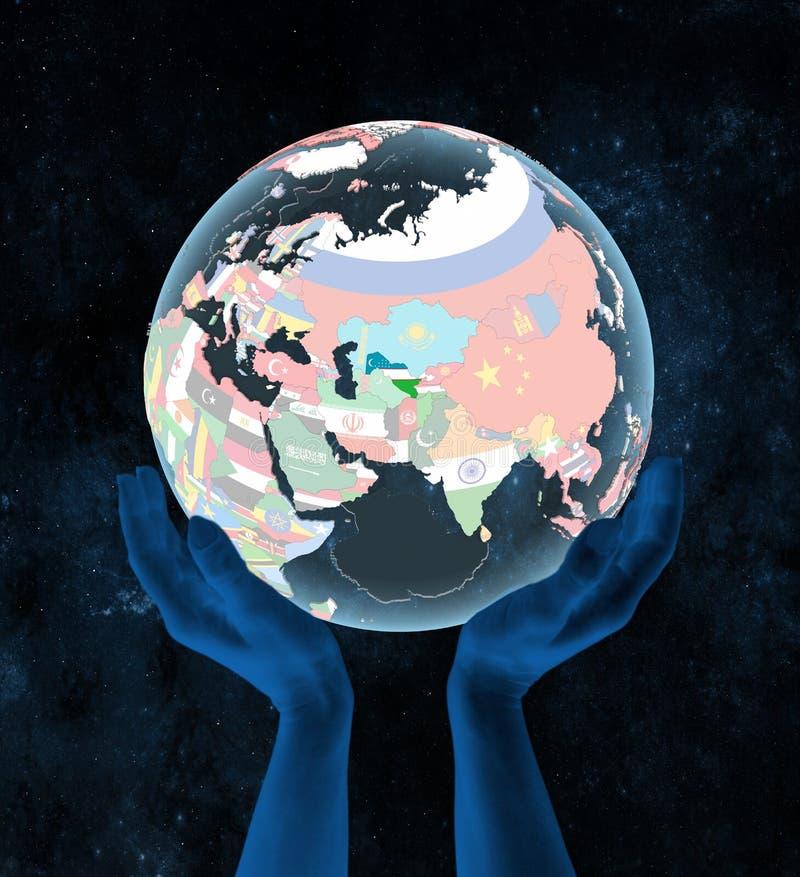 Uzbekistan na politycznej kuli ziemskiej w rękach ilustracji