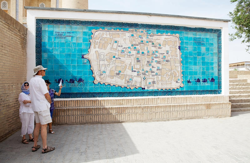 Uzbekistan. Tourists in front of the map of the Itchan Kala, Khiva, Uzbekistan. Itchan Kala is the walled inner town of the city of Khiva. Since 1990 it has been royalty free stock photography