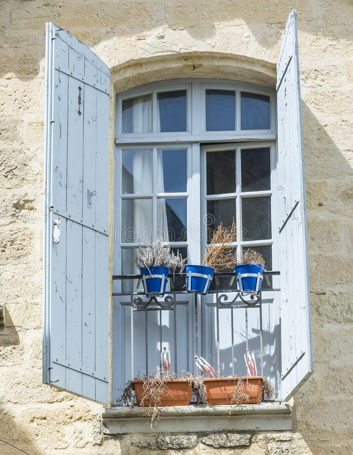 Download Uzes (France) stock photo. Image of lamp, window, architecture - 34117210