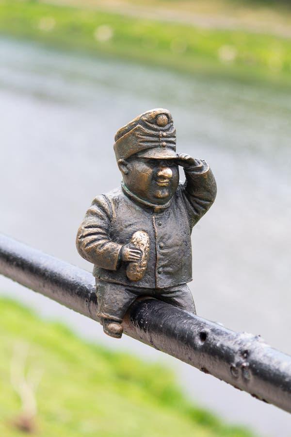 Uzhgorod, Ukraine - April 27, 2016: Small bronze statue of Good Soldier Svejk attached to the handrails. At Kyivska embankment of the river Uzh stock images