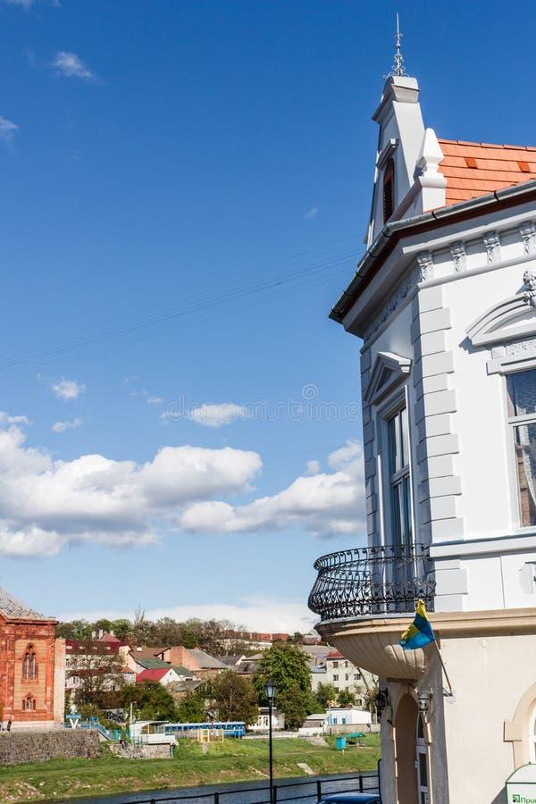 UZHGOROD, UKRAINE-APRIL 23, 2017: View on the city with facade of historical building foreground. Uzhgorod is city in. UZHGOROD, UKRAINE-APRIL 23, 2017: View on royalty free stock image