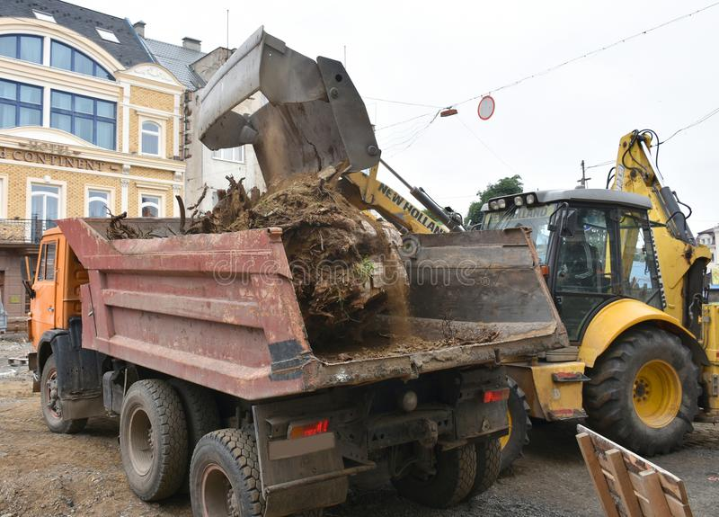 UZHHOROD, UKRAINE - JUNE 27, 2018: Excavator used to dig up tree stock photos