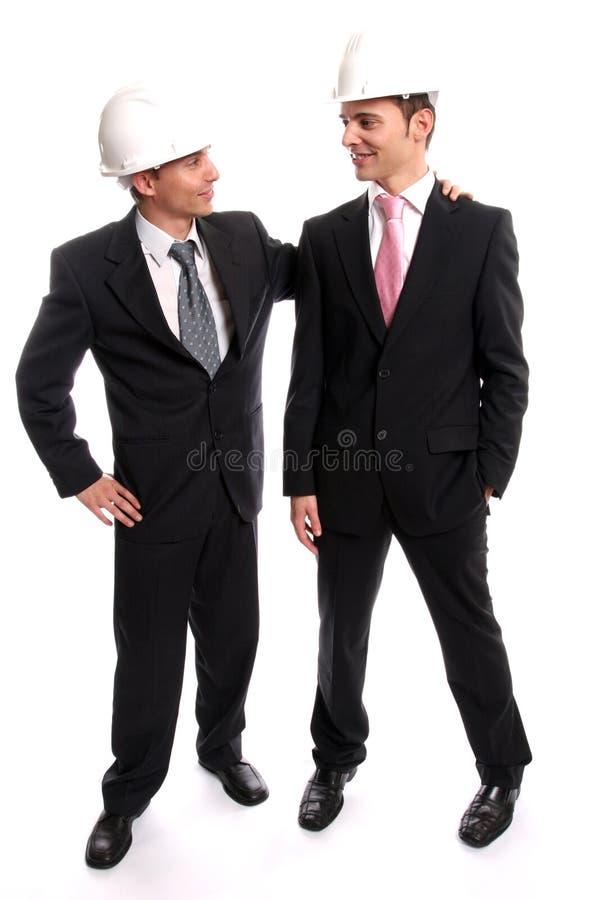 uzupełniające umowę w dwóch młodych zdjęcia stock