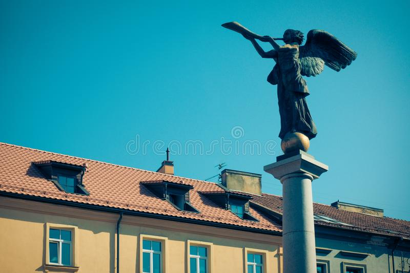 Uzupis Angel, statue of an angel blowing a trumpet in the main square, symbol quarter of an independent republic Uzupis royalty free stock photos