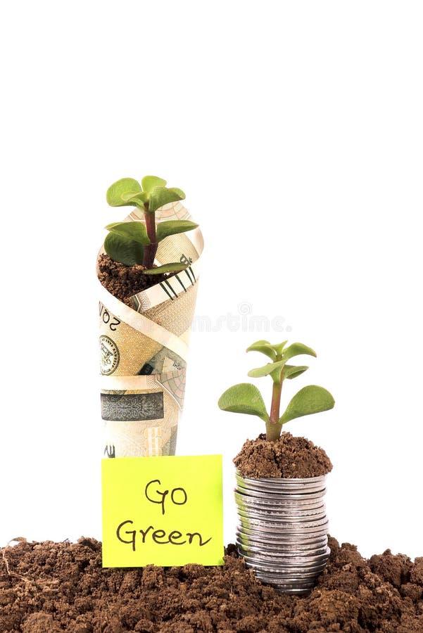 Vá verde e conserve o dinheiro imagem de stock