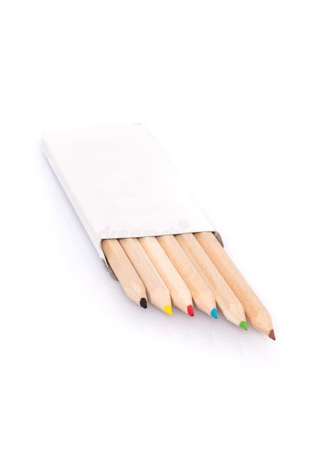 A vária cor escreve na caixa no fundo branco imagem de stock