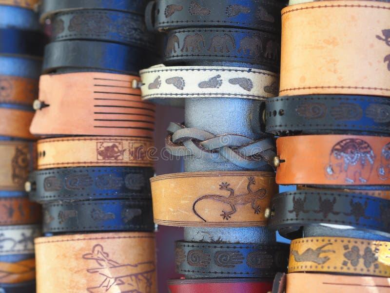 Vários braceletes de couro fotografia de stock