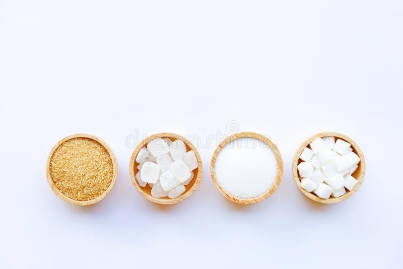 Vários tipos de açúcar no branco fotos de stock