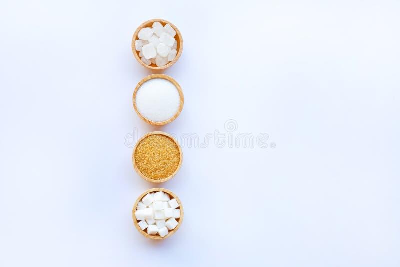 Vários tipos de açúcar no branco fotografia de stock