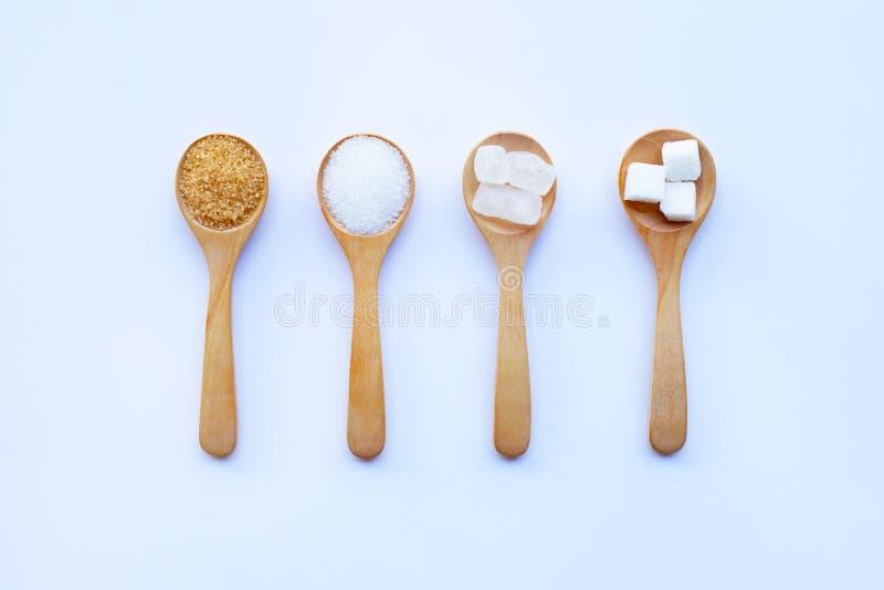 Vários tipos de açúcar no fundo branco fotografia de stock