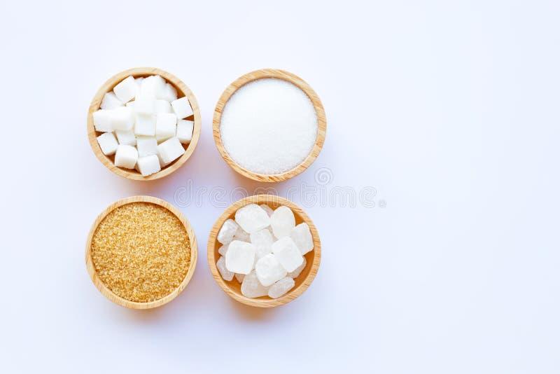Vários tipos de açúcar no fundo branco foto de stock royalty free