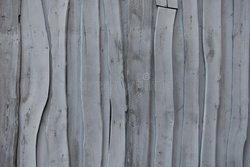 Vägg av gamla gråa abstrakta bräden royaltyfri bild