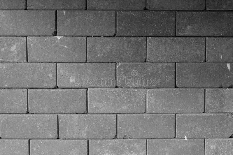 vägg för bakgrundstegelstengrey royaltyfria bilder
