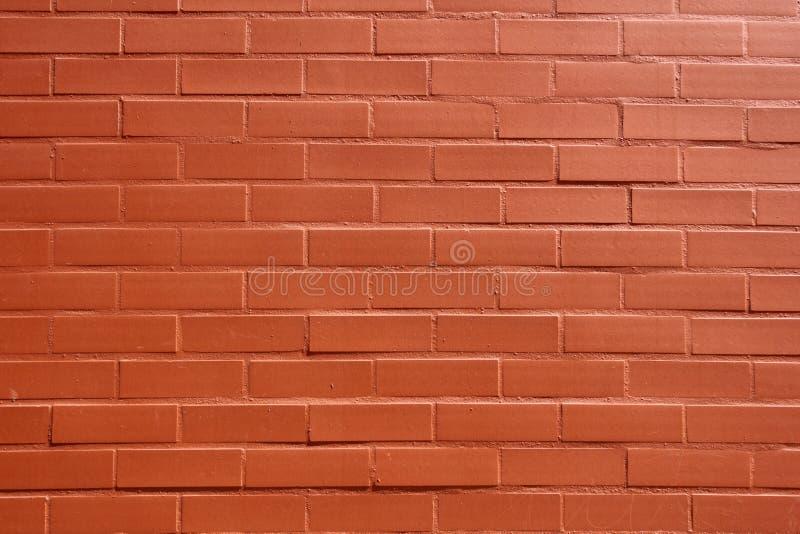 vägg för bakgrundstegelstenorange arkivbilder