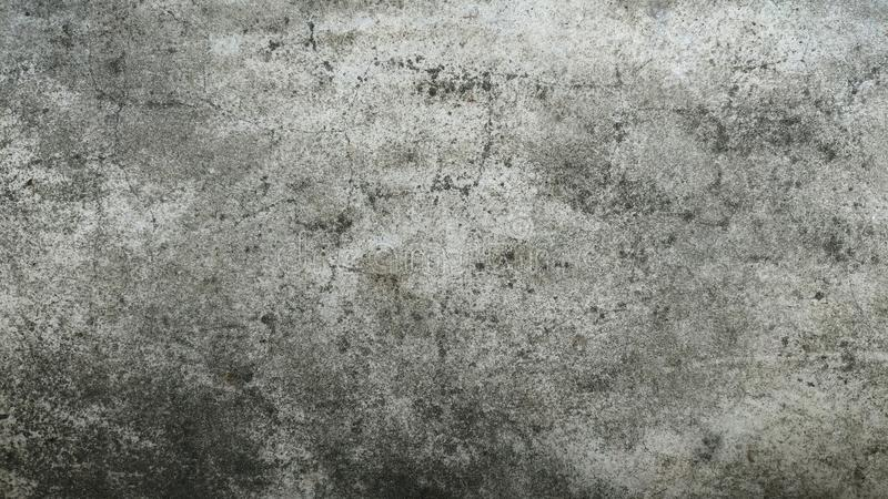 Vägg för Grungebetongcement med sprickan royaltyfria foton