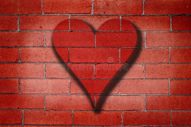 vägg för tegelstengrafittihjärta fotografering för bildbyråer