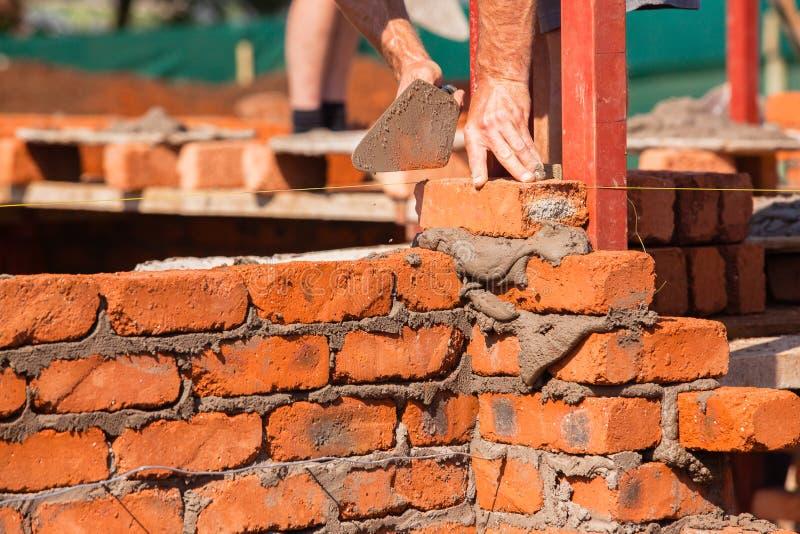 Väggar för byggnadsmurerihantverkare arkivfoto