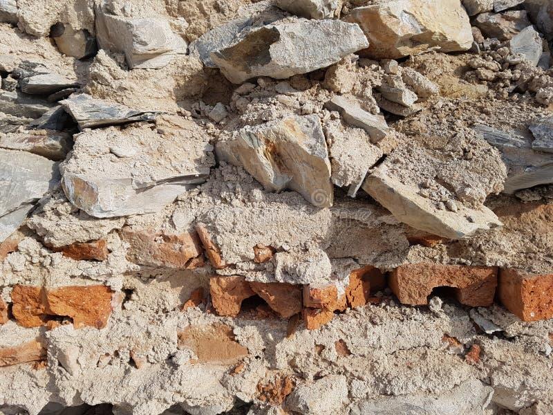 Väggbakgrund från stenar och tegelstenar royaltyfri foto