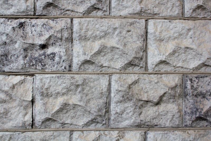 Väggen stenen, bakgrund, textur som är naturlig, vaggar, abstrakt begrepp, modellen, arkitektur, material, yttersida som är gamma royaltyfria bilder
