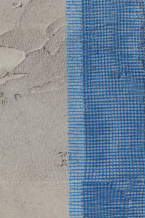 Väggisolering, mortel och ingrepp arkivbild