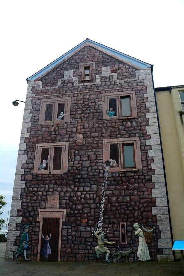 Väggmålning på väggen, Carrickfergus som är nordlig - Irland arkivbild