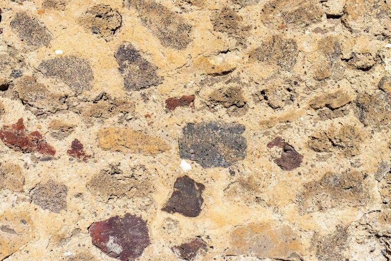 Väggtextur av den forntida gamla tegelstenstenen Utomhus- yttre hus i Pompeii royaltyfri foto