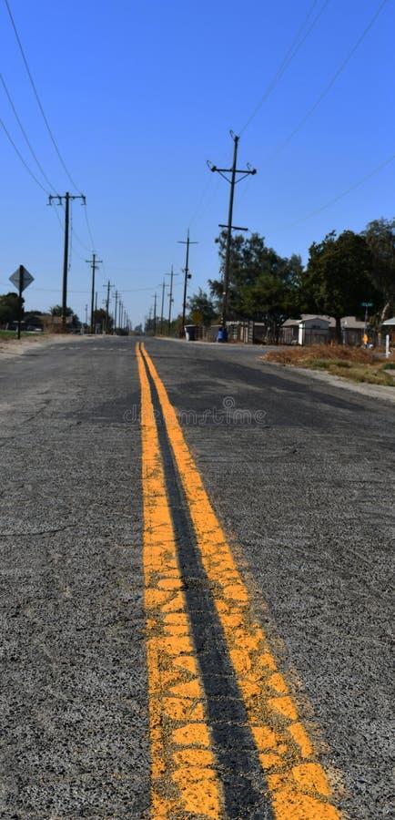 Vägkörning/asfalt av vägen för trans. för billopp royaltyfri foto