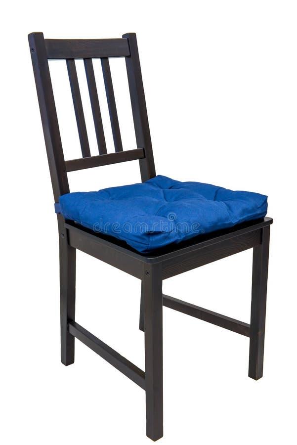 Väl till mods stol med en kudde royaltyfria foton