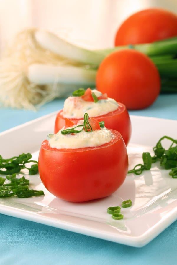 Välfyllda tomater arkivfoton