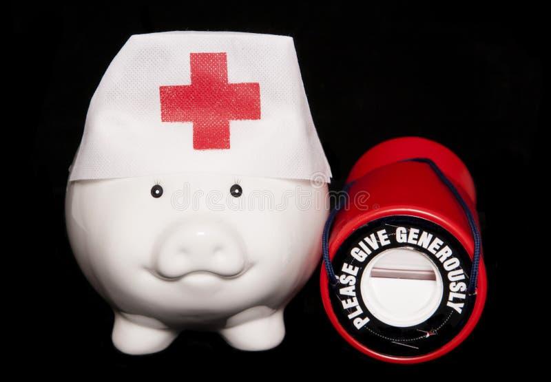 Välgörenhetsjukvårdspargris arkivfoton