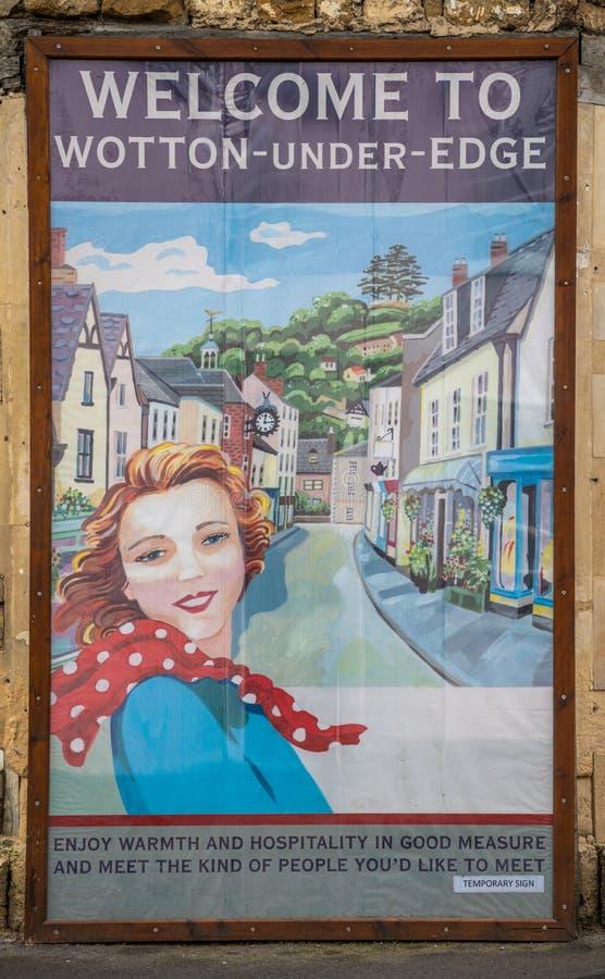 Välkommen affisch i Wotton under kanten, Cotswoldsen, Gloucestershire royaltyfria bilder