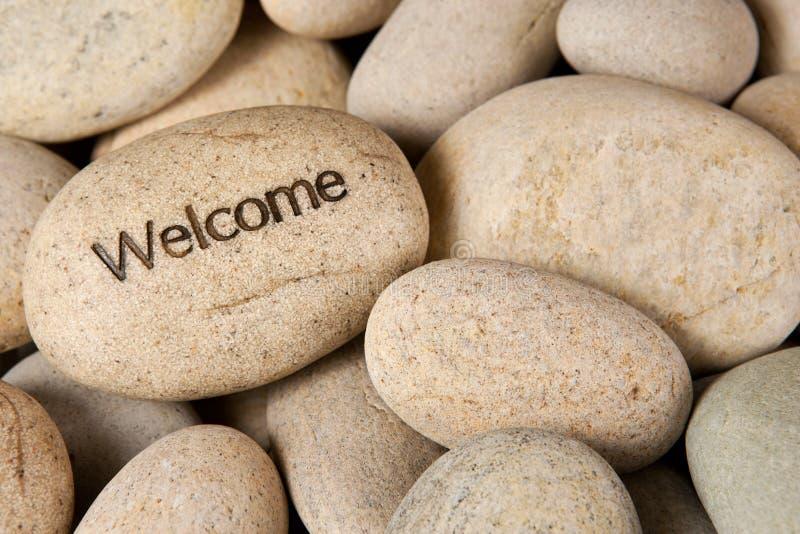 Välkommen sten arkivbild