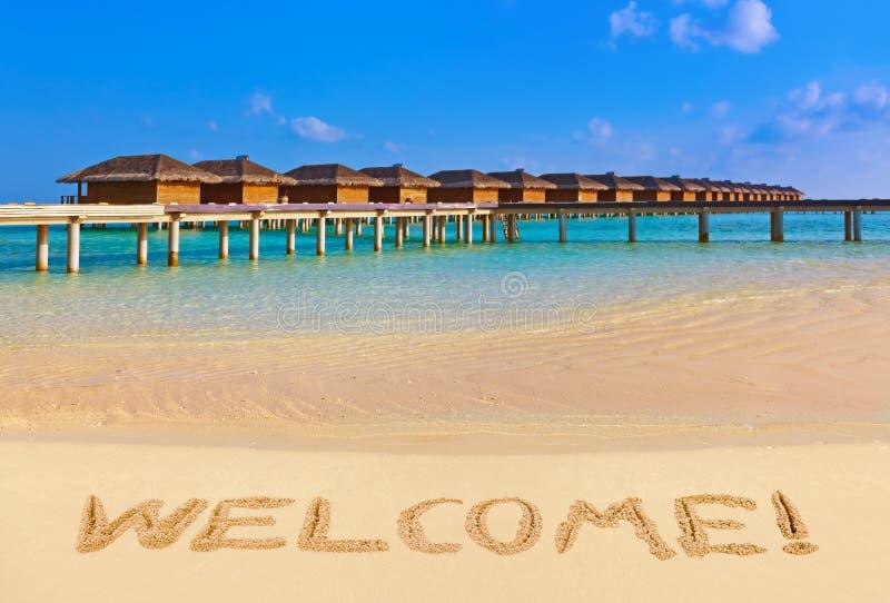 välkommet ord för strand arkivfoton
