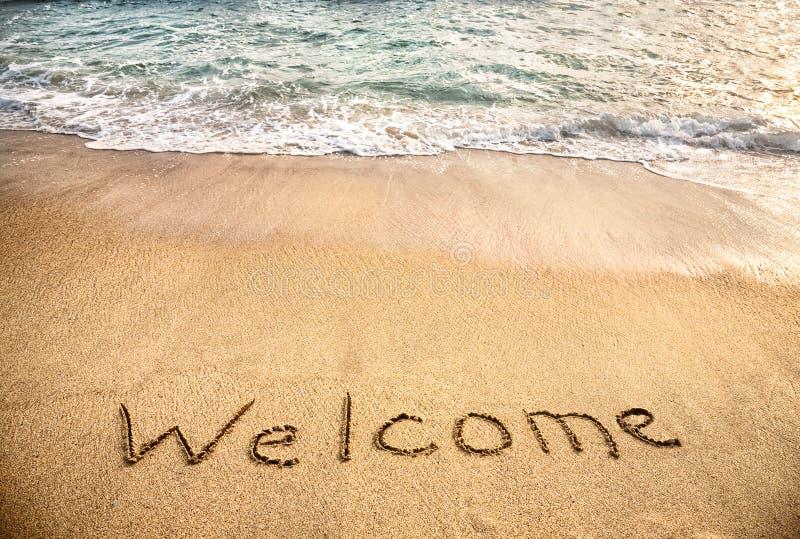 Välkommet ord på sanden royaltyfria foton