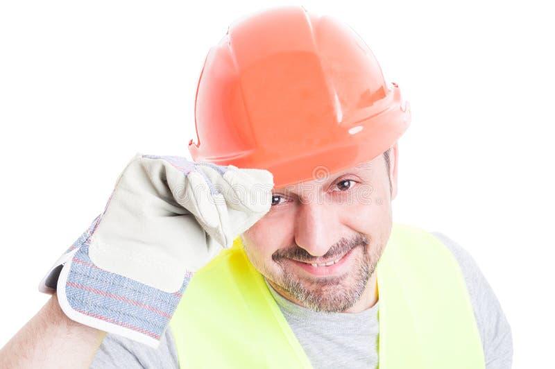 Välkomnande begrepp med den stiliga byggmästaren i closeup arkivbild