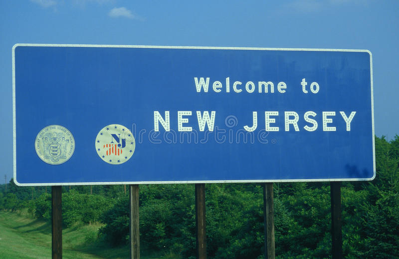 Välkomnande till det New Jersey tecknet royaltyfria bilder