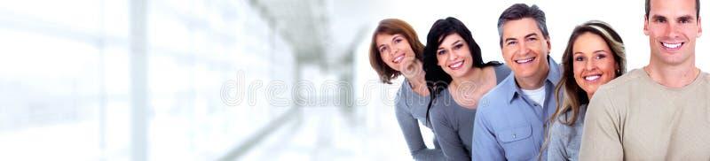 vänder att le för folk mot royaltyfri bild