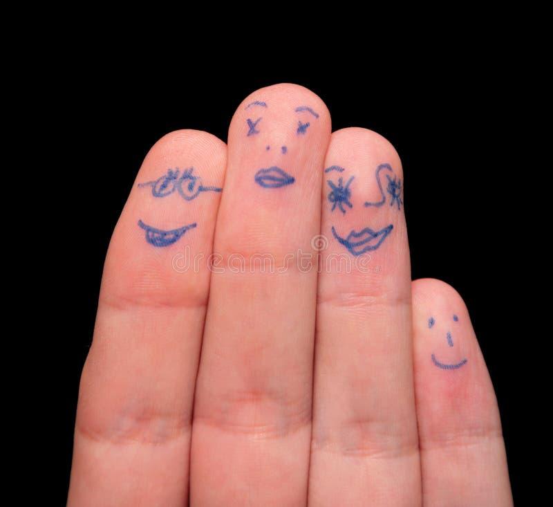 vänder målade fingrar mot royaltyfri foto