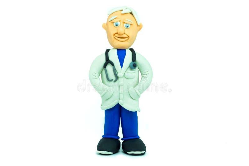 Vänlig doktor som göras, i att le för plasticine royaltyfria foton
