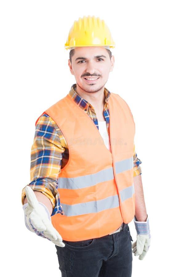 Vänligt agera för konstruktör som är säkert, och göra handskakagestu royaltyfri fotografi