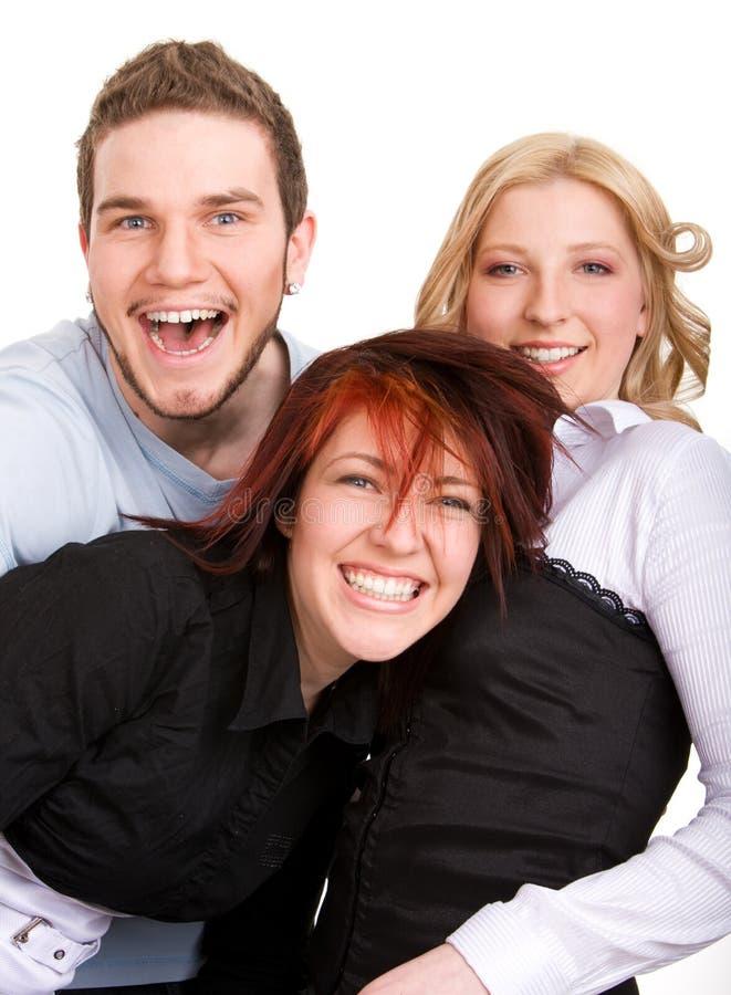 vänner lyckliga tre royaltyfri bild