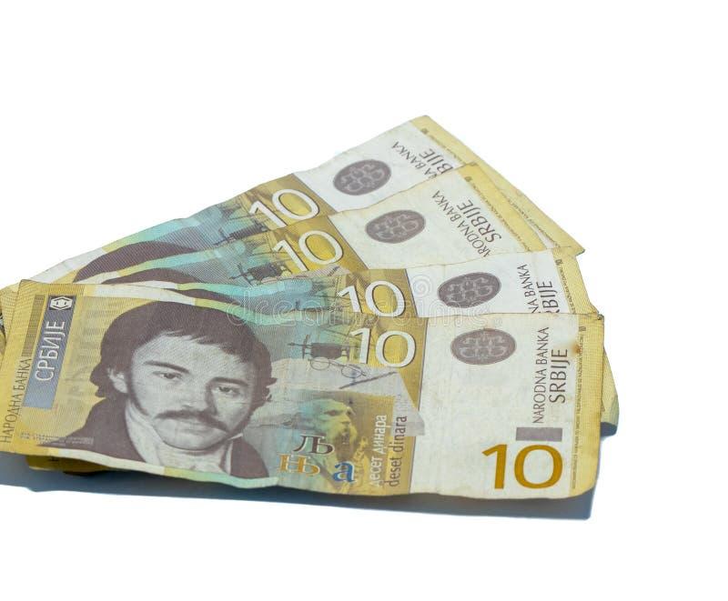 Värde för fyra sedlar 10 serbiska dinar med en stående av en lingvist Vuk Karadzic som isoleras på en vit bakgrund royaltyfri fotografi