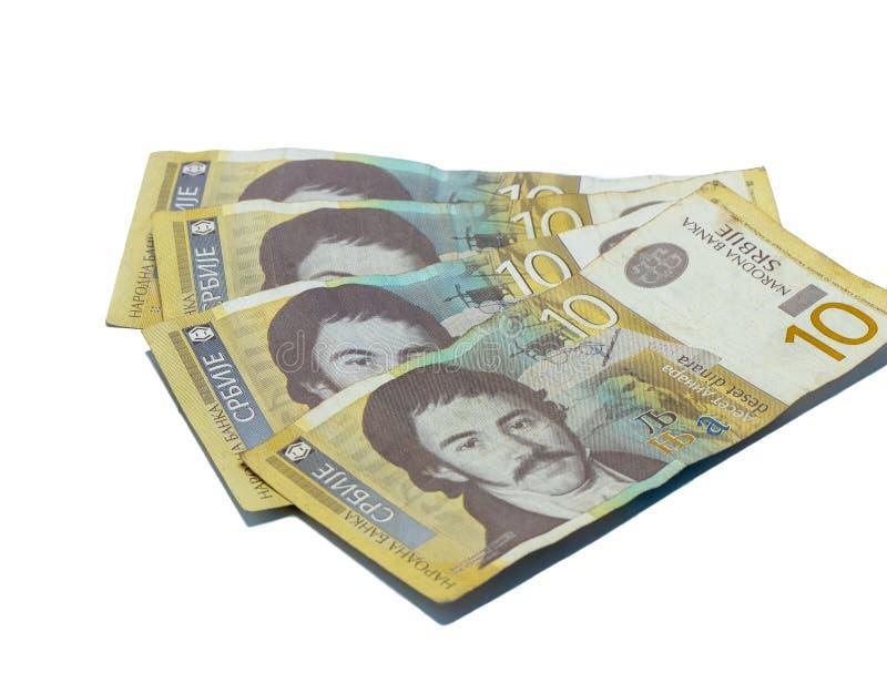 Värde för fyra sedlar 10 serbiska dinar med en stående av en lingvist Vuk Karadzic som isoleras på en vit bakgrund arkivfoton