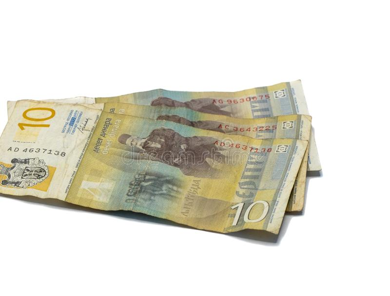 Värde för tre sedlar 10 serbiska dinar med en stående av en lingvist Vuk Karadzic som isoleras på en vit bakgrund royaltyfria foton