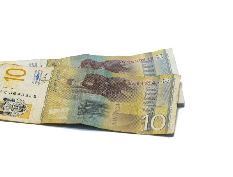 Värde för två sedlar 10 serbiska dinar med en stående av en lingvist Vuk Karadzic som isoleras på en vit bakgrund arkivfoton