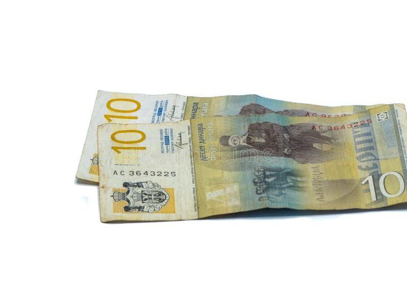Värde för två sedlar 10 serbiska dinar med en stående av en lingvist Vuk Karadzic som isoleras på en vit bakgrund royaltyfri bild