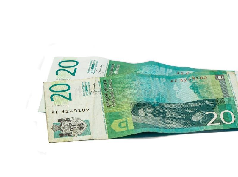 Värde för två sedlar 20 serbiska dinar med en stående av linjalen av Montenegro Peter II Petrovich som isoleras på vit bakgrund royaltyfri fotografi