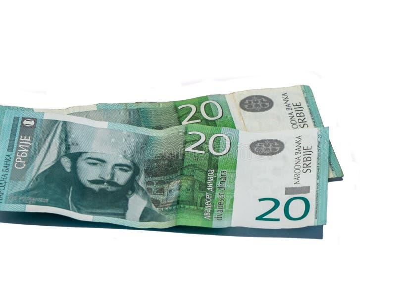 Värde för två sedlar 20 serbiska dinar med en stående av linjalen av Montenegro Peter II Petrovich som isoleras på vit bakgrund royaltyfria foton