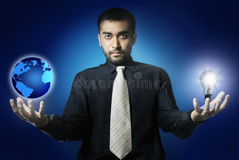 värld för man för kulaholdinglampa royaltyfri bild